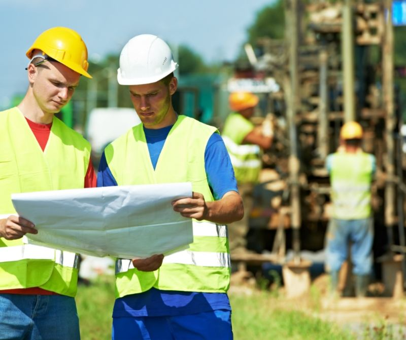 2 Workmen looking at Home Plans
