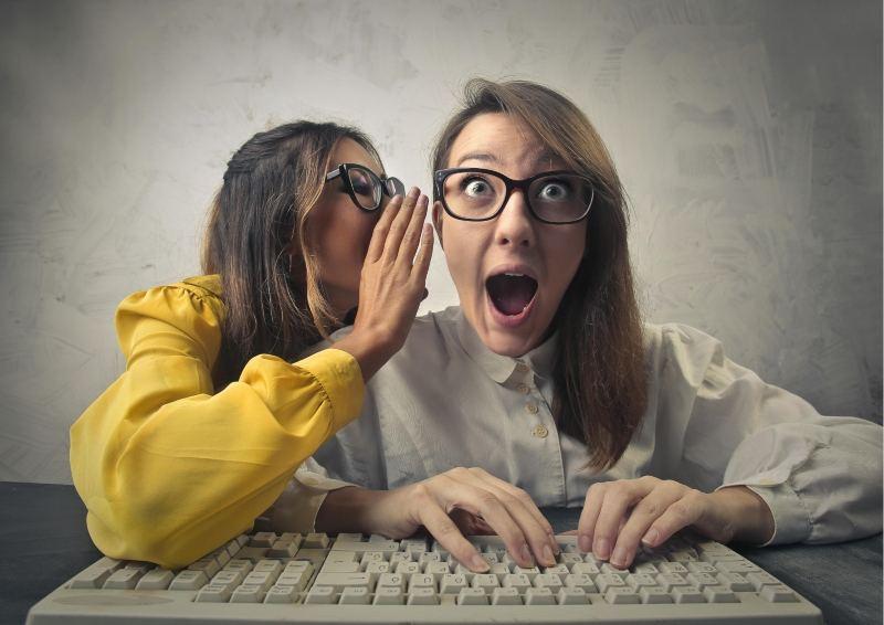 2 Women telling a Secret