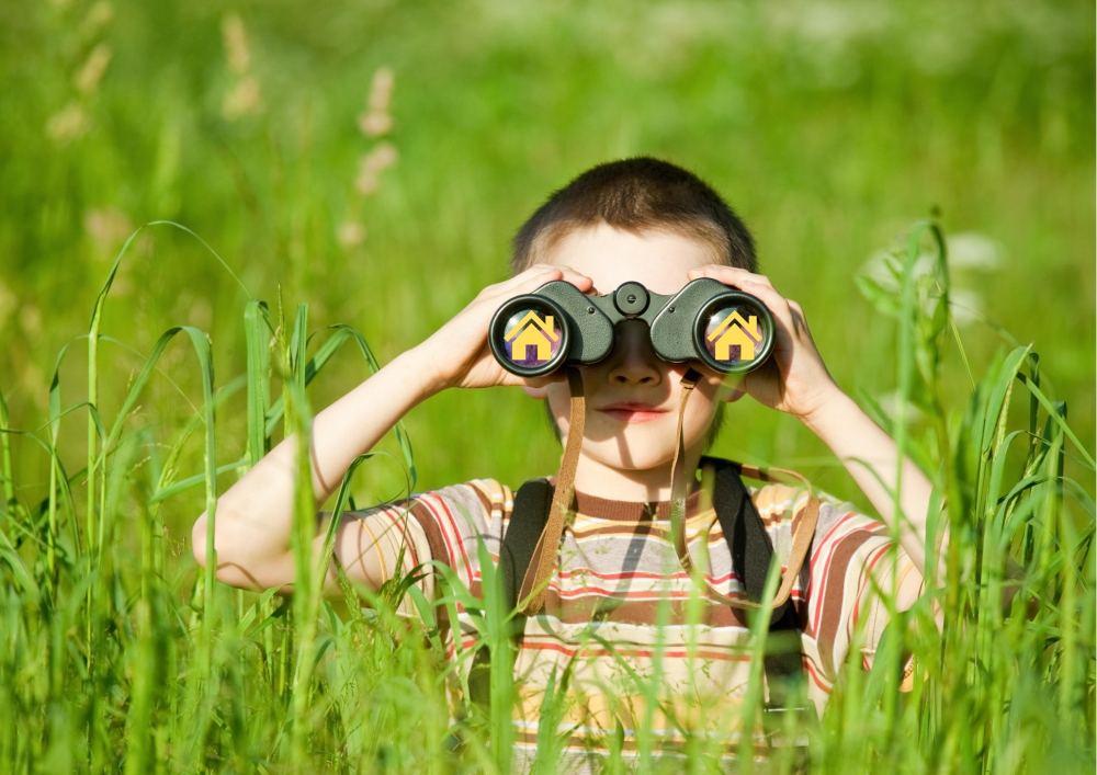 Boy Looking Through Binculars