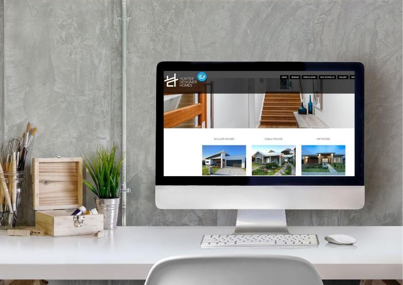 Computer Showing Hunter Designer Homes Website