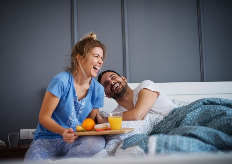 Couple having Breakfast bed In new home