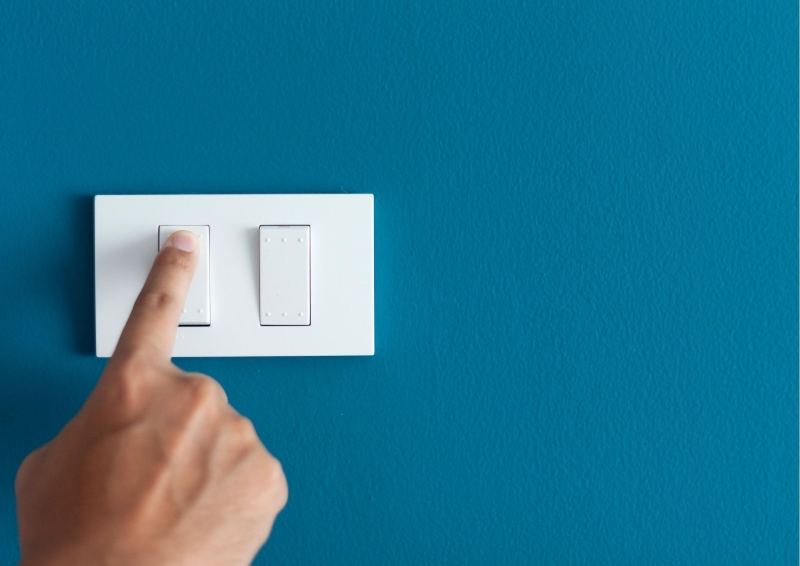 Turning on a light switch in your new Hunter Designer Home
