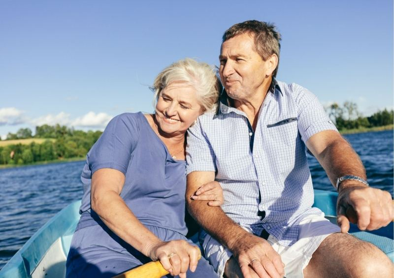 Older Couple in a row boat