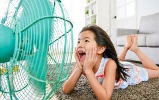 Girl Laying in front of fan