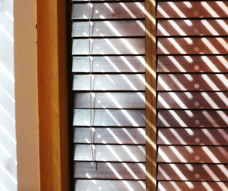 You don't need to get rid of blinds in order to maximise the amount of natural light in your home. You can purchase fully retractable or removal blinds, shutters or curtains to get the best of both worlds. Think about shutters. You can open the slats just a bit to let in some light but close them to ensure your privacy. You can also completely retract them so to completely allow the sunlight to enter your home. You can also play around with the slats in venetian blinds and even change the direction of your slats to allow in the perfect amount of light.