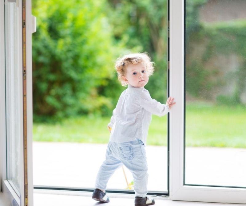 Child at glass door