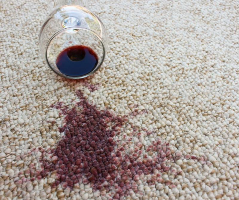 Red wine spilt on carpet