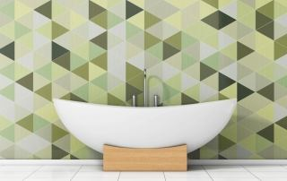 Bath with a fancy green tile wall